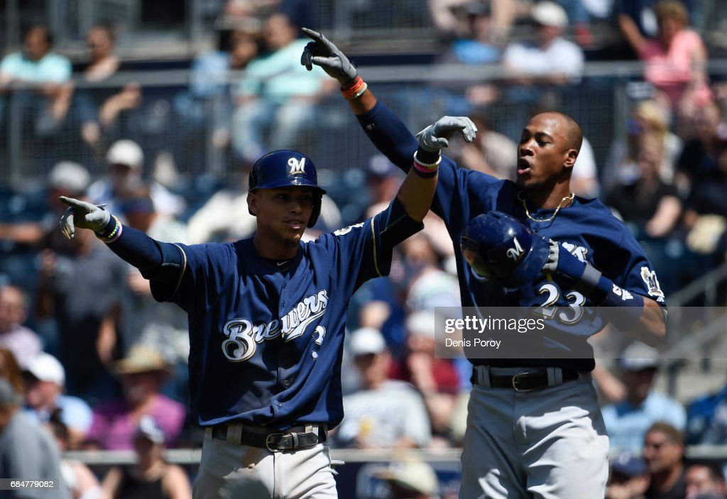 Orlando Arcia #3 and Keon Broxton #23 of the Milwaukee Brewers celebrate after scoring during the seventh inning of a baseball game against the San Diego Padres at PETCO Park on May 18, 2017 in San Diego, California.
