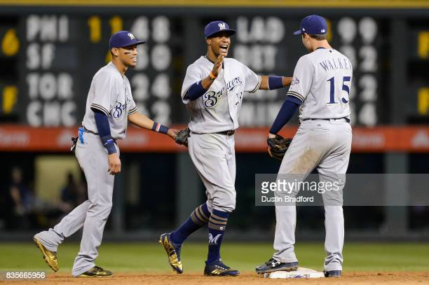 Orlando Arcia Keon Broxton and Neil Walker of the Milwaukee Brewers celebrate a 63 win over the Colorado Rockies at Coors Field on August 19 2017 in...