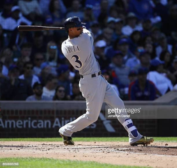 Orlando Arcia of the Milwaukee Brewers bats against the Chicago Cubs at Wrigley Field on September 9 2017 in Chicago Illinois The Brewers defeated...
