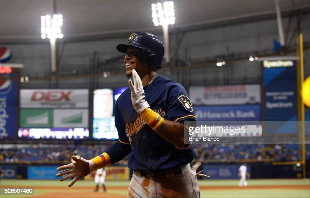Orlando Arcia of the Milwaukee Brewers celebrates as he makes his way back to the dugout after hitting a home run off of pitcher Sergio Romo of the...