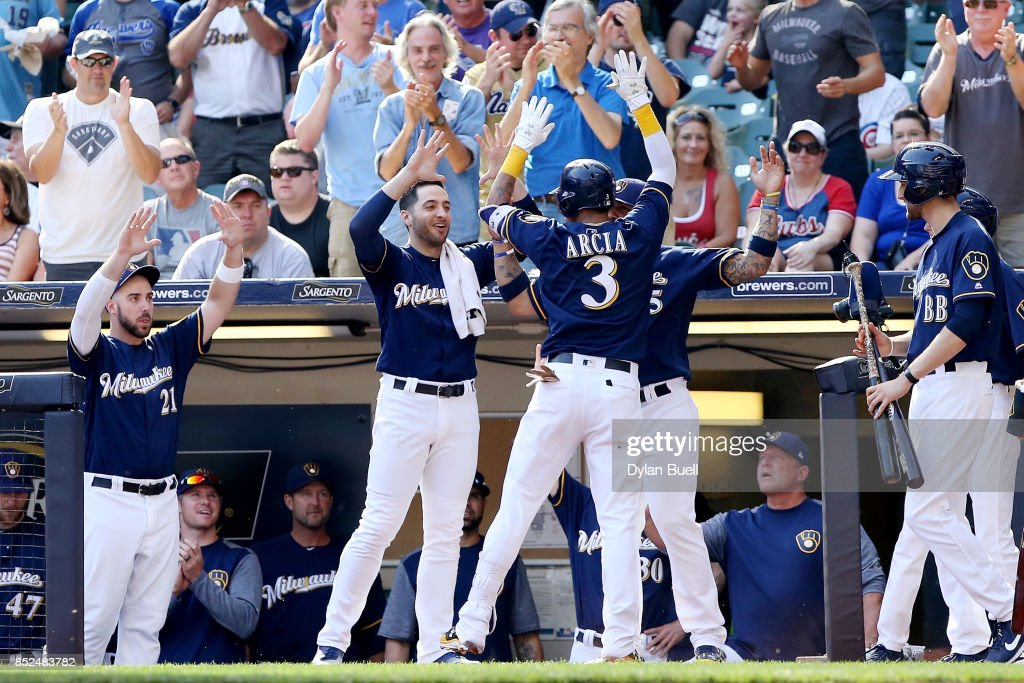 Orlando Arcia #3 of the Milwaukee Brewers celebrates with teammates after hitting a home run in the ninth inning against the Chicago Cubs at Miller Park on September 23, 2017 in Milwaukee, Wisconsin.