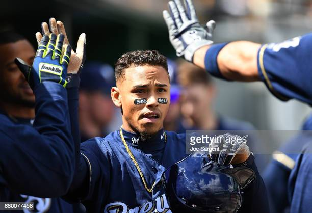 Orlando Arcia of the Milwaukee Brewers celebrates with teammates after scoring during the fifth inning against the Pittsburgh Pirates at PNC Park on...