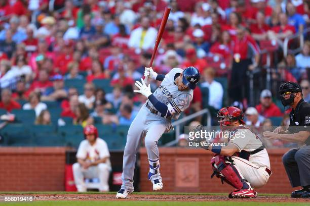Orlando Arcia of the Milwaukee Brewers dodges an inside pitch against the St Louis Cardinals in the second inning at Busch Stadium on September 30...