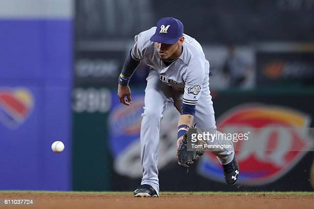 Orlando Arcia of the Milwaukee Brewers fields a ground ball hit by Nomar Mazara of the Texas Rangers in the bottom of the sixth inning at Globe Life...