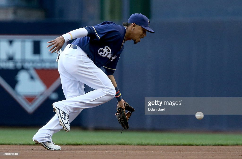 Orlando Arcia #3 of the Milwaukee Brewers fields a ground ball in the first inning against the Colorado Rockies at Miller Park on August 22, 2016 in Milwaukee, Wisconsin.