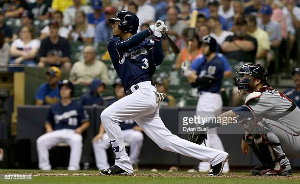 Orlando Arcia of the Milwaukee Brewers hits a double in the eighth inning against the Atlanta Braves at Miller Park on August 8 2016 in Milwaukee...