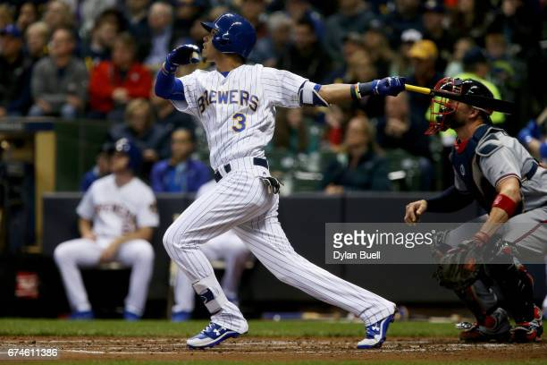 Orlando Arcia of the Milwaukee Brewers hits a home run in the second inning against the Atlanta Braves at Miller Park on April 28 2017 in Milwaukee...