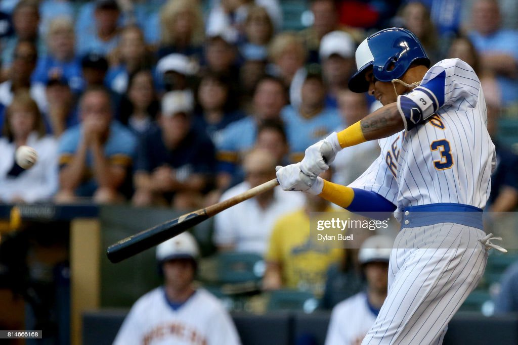 Orlando Arcia #3 of the Milwaukee Brewers hits a home run in the second inning against the Philadelphia Phillies at Miller Park on July 14, 2017 in Milwaukee, Wisconsin.