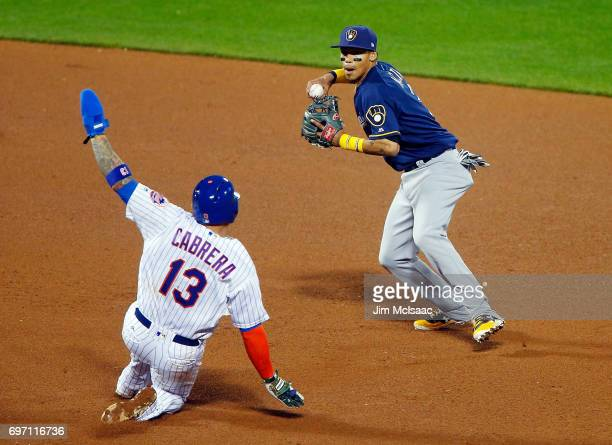 Orlando Arcia of the Milwaukee Brewers in action against Asdrubal Cabrera of the New York Mets at Citi Field on May 31 2017 in the Flushing...