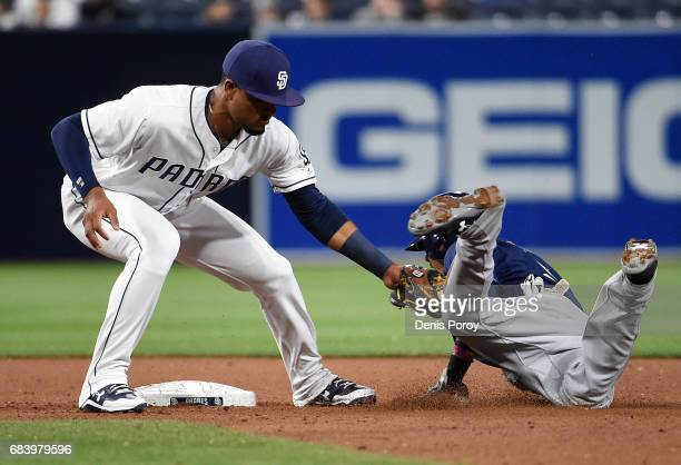 Orlando Arcia of the Milwaukee Brewers is tagged out at second base by Allen Cordoba of the San Diego Padres as he tries to steal during the eighth...