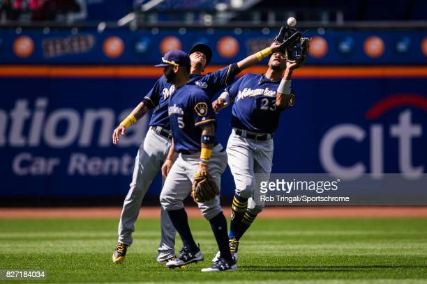 Orlando Arcia of the Milwaukee Brewers makes a catch over Keon Broxton during the game against the New York Mets at Citi Field on June 1 2017 in the...