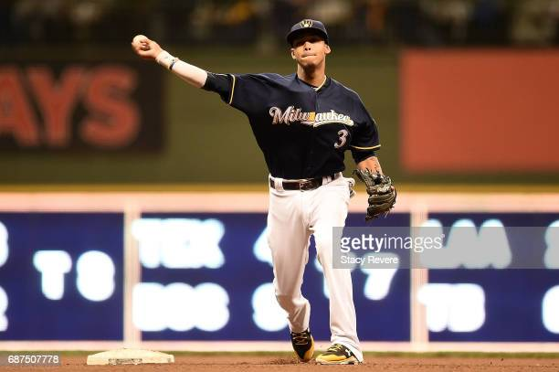 Orlando Arcia of the Milwaukee Brewers makes a throw to first base during the sixth inning of a game against the Toronto Blue Jays at Miller Park on...