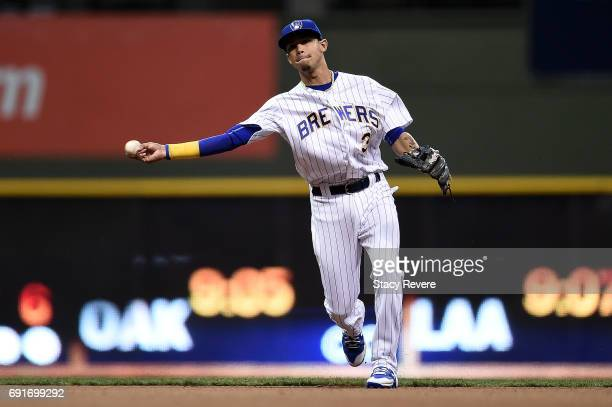 Orlando Arcia of the Milwaukee Brewers makes a throw to first base during the sixth inning of a game against the Los Angeles Dodgers at Miller Park...