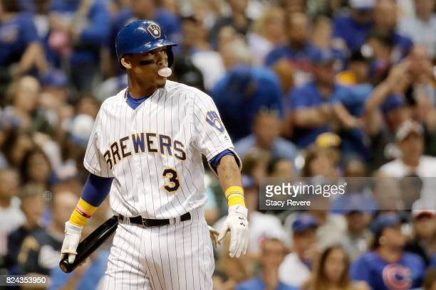Orlando Arcia of the Milwaukee Brewers reacts to a strike out during the seventh inning of a game against the Chicago Cubs at Miller Park on July 29...