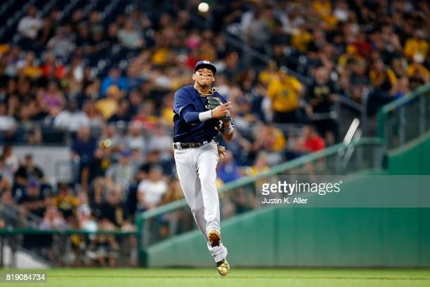 Orlando Arcia of the Milwaukee Brewers records a put out against the Pittsburgh Pirates at PNC Park on July 19 2017 in Pittsburgh Pennsylvania