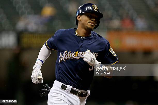 Orlando Arcia of the Milwaukee Brewers rounds the bases after hitting a home run in the seventh inning against the St Louis Cardinals at Miller Park...