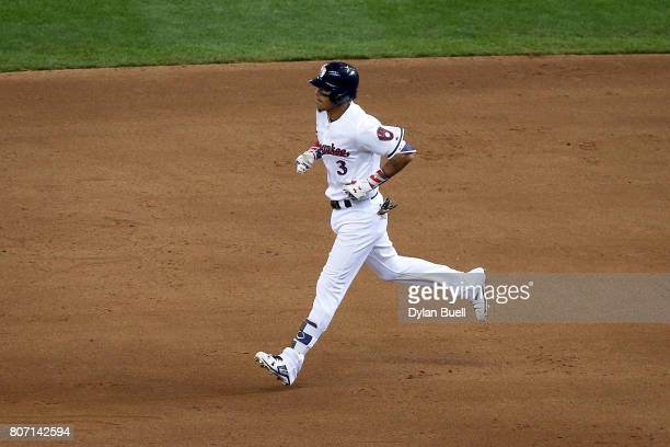 Orlando Arcia of the Milwaukee Brewers rounds the bases after hitting a home run in the fifth inning against the Miami Marlins at Miller Park on July...