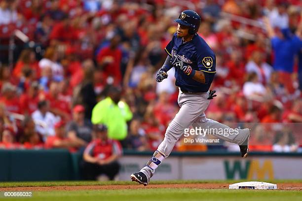 Orlando Arcia of the Milwaukee Brewers rounds third base after hitting a solo home run against the St Louis Cardinals in the second inning at Busch...