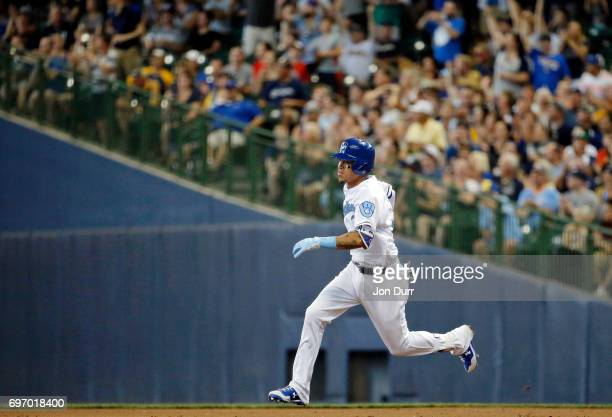 Orlando Arcia of the Milwaukee Brewers runs to second base on his insidethepark homerun against the San Diego Padres during the third inning at...