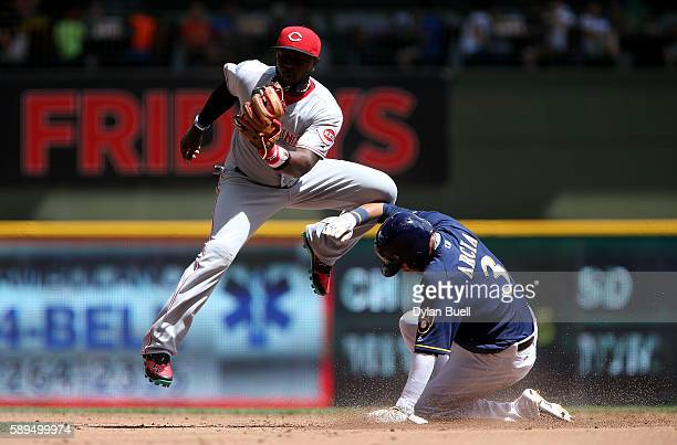 Orlando Arcia of the Milwaukee Brewers steals second base past Brandon Phillips of the Cincinnati Reds in the first inning at Miller Park on August...
