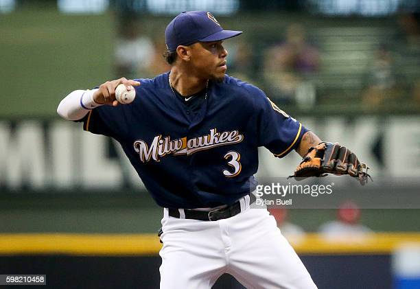 Orlando Arcia of the Milwaukee Brewers throws to first base in the third inning against the St Louis Cardinals at Miller Park on August 29 2016 in...