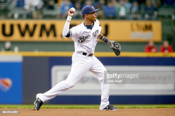 Orlando Arcia of the Milwaukee Brewers throws to first base in the fifth inning against the Colorado Rockies of the MLB Opening Day game at Miller...