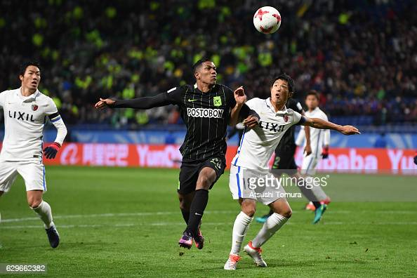 Orlando Berrio of Atletico Nacional and Shuhei Akasaki of Kashima Antlers compete for the ball during the FIFA Club World Cup Japan semifinal match...