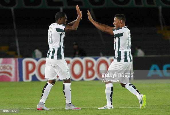 Orlando Berrio of Atletico Nacional celebrates with his teammate after scoring during a match between Deportes Tolima and Atletico Nacional as part...