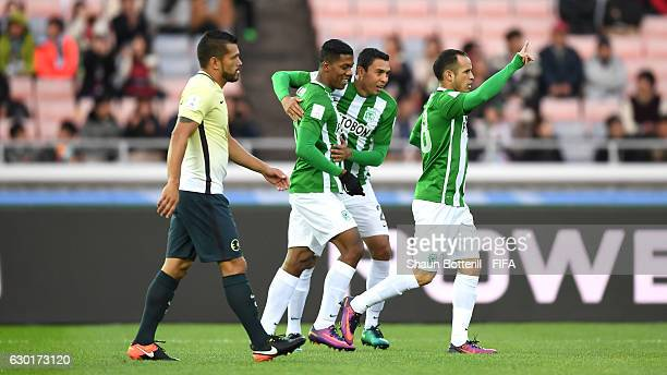 Orlando Berrio of Atletico Nacional celebrates with team mates after Miguel Samudio of Club America scores an own goal during the FIFA Club World Cup...