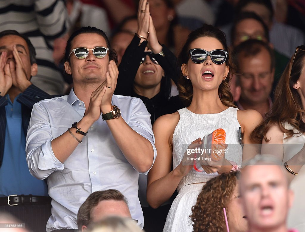 Orlando Bloom and Kate Beckinsale attend the mens singles final between Novak Djokovic and Roger Federer on centre court during day thirteen of the Wimbledon Championships at Wimbledon on July 6, 2014 in London, England.