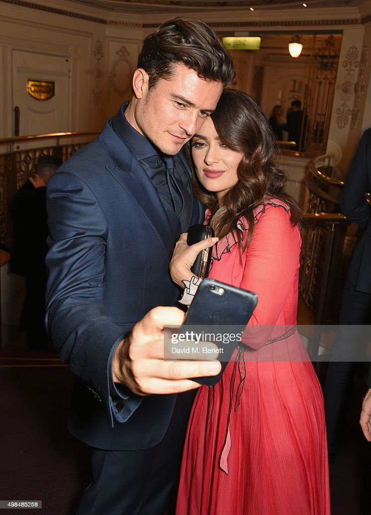 Orlando Bloom (L) and Salma Hayek attend the British Fashion Awards in partnership with Swarovski at the London Coliseum on November 23, 2015 in London, England.