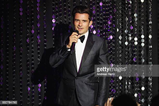 Orlando Bloom appears on stage at the amfAR's 23rd Cinema Against AIDS Gala at Hotel du CapEdenRoc on May 19 2016 in Cap d'Antibes France