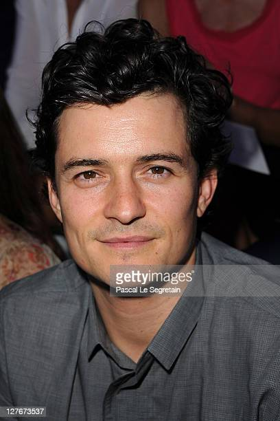 Orlando Bloom attends the Christian Dior Ready to Wear Spring / Summer 2012 show during Paris Fashion Week at Musee Rodin on September 30 2011 in...