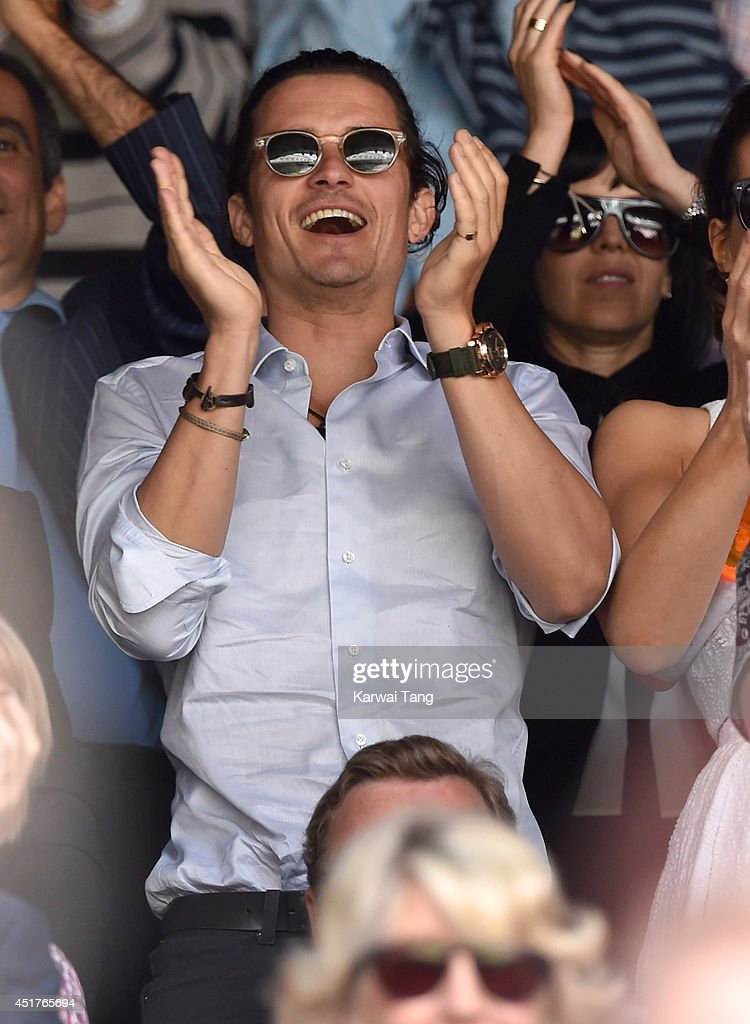 Orlando Bloom attends the mens singles final between Novak Djokovic and Roger Federer on centre court during day thirteen of the Wimbledon Championships at Wimbledon on July 6, 2014 in London, England.