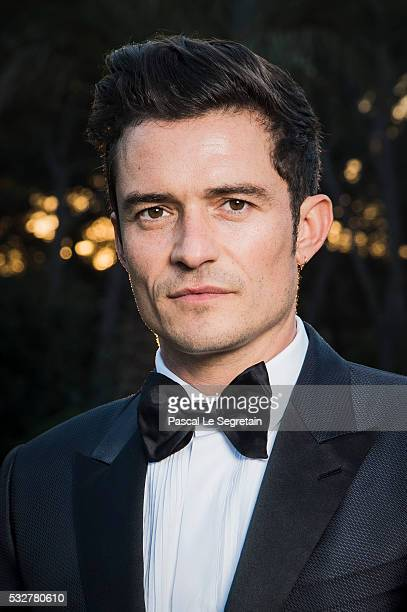Orlando Bloom poses for photographs at the amfAR's 23rd Cinema Against AIDS Gala at Hotel du CapEdenRoc on May 19 2016 in Cap d'Antibes France