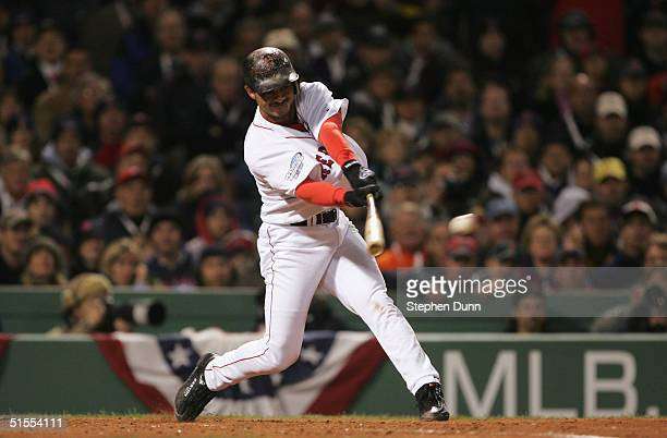 Orlando Cabrera of the Boston Red Sox hits a RBI single to score Doug Mirabelli during third inning of game one of the World Series against the St...