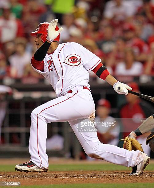 Orlando Cabrera of the Cincinnati Reds hits a single during the game against the Pittsburgh Pirates at Great American Ball Park on May 26 2010 in...