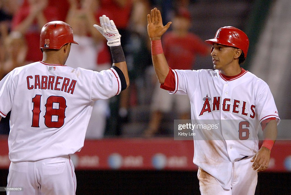 <a gi-track='captionPersonalityLinkClicked' href=/galleries/search?phrase=Orlando+Cabrera&family=editorial&specificpeople=175863 ng-click='$event.stopPropagation()'>Orlando Cabrera</a> of the Los Angeles Angels of Anaheim (18) is congratulated by <a gi-track='captionPersonalityLinkClicked' href=/galleries/search?phrase=Maicer+Izturis&family=editorial&specificpeople=239100 ng-click='$event.stopPropagation()'>Maicer Izturis</a> after a two-run home run in the fourth inning of 10-5 victory over the Cleveland Indians at Angel Stadium in Anaheim, California on Monday, July 17, 2006.