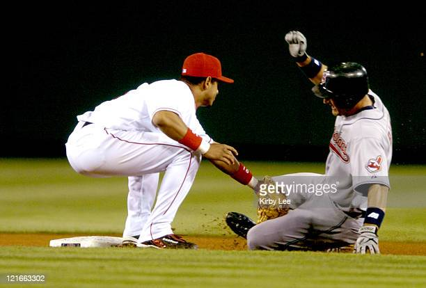 Orlando Cabrera of the Los Angeles Angels of Anaheim tags out Casey Blake of the Cleveland Indians at second base on a stolen base attempt in the...