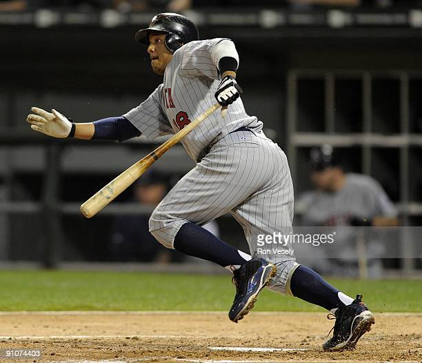 Orlando Cabrera of the Minnesota Twins hits an RBI single in the fourth inning against the Chicago White Sox on September 23 2009 at US Cellular...