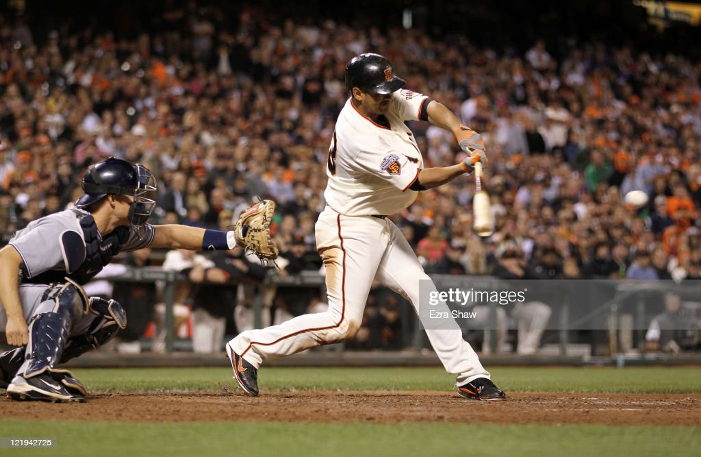 <a gi-track='captionPersonalityLinkClicked' href=/galleries/search?phrase=Orlando+Cabrera&family=editorial&specificpeople=175863 ng-click='$event.stopPropagation()'>Orlando Cabrera</a> #43 of the San Francisco Giants hits a single that scored Aaron Rowand #33 to tie their game against the San Diego Padres in the eighth inning at AT&T Park on August 23, 2011 in San Francisco, California.