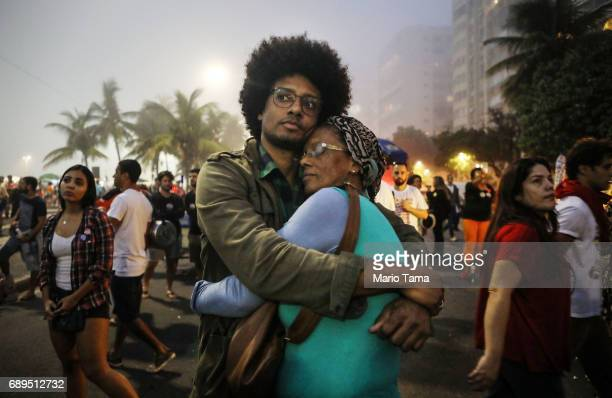 Orlando Caldeira embraces his mother Georgina at a demonstration and concert calling for direct presidential elections on May 28 2017 in Rio de...