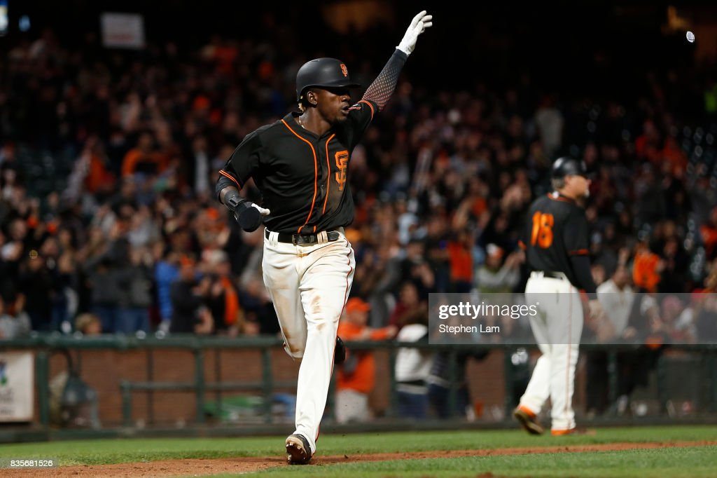 Orlando Calixte #46 gestures as he runs towards home plate during the ninth inning against the Philadelphia Phillies at AT&T Park on August 19, 2017 in San Francisco, California. The Phillies defeated the Giants 12-9.