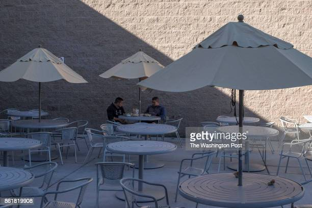 Orlando Calzadillas L and brother Fancisco Calzadillas share a meal together in the almost empty cafeteria patio at the University Medical Center in...