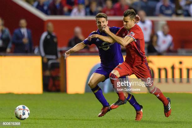 Orlando City FC midfielder Victor Giro defends Chicago Fire forward Luis Solignac in the second half during an MLS soccer match between Orlando City...