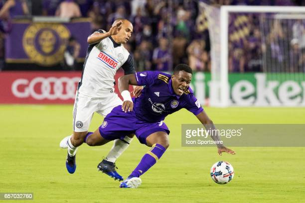 Orlando City SC forward Cyle Larin is tripped up by Philadelphia Union defender Fabinho during the soccer match between the Orlando City Lions and...
