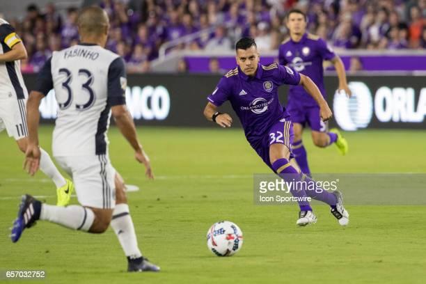 Orlando City SC midfielder Matias Perez Garcia defends against Philadelphia Union defender Fabinho during the soccer match between the Orlando City...