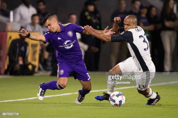 Orlando City SC midfielder Matias Perez Garcia is blocked by Philadelphia Union defender Fabinho during the soccer match between the Orlando City...