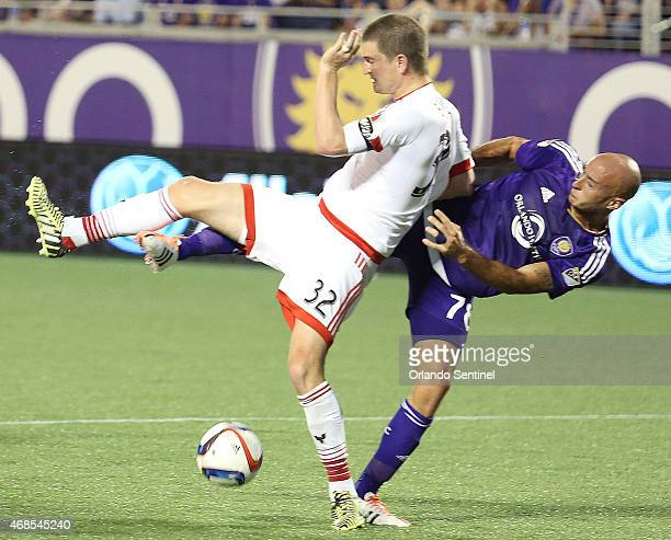 Orlando City's Aurelien Collin and DC United's Bobby Boswell battle for the ball at the Orlando Citrus Bowl on Friday April 3 2015 DC United won 10