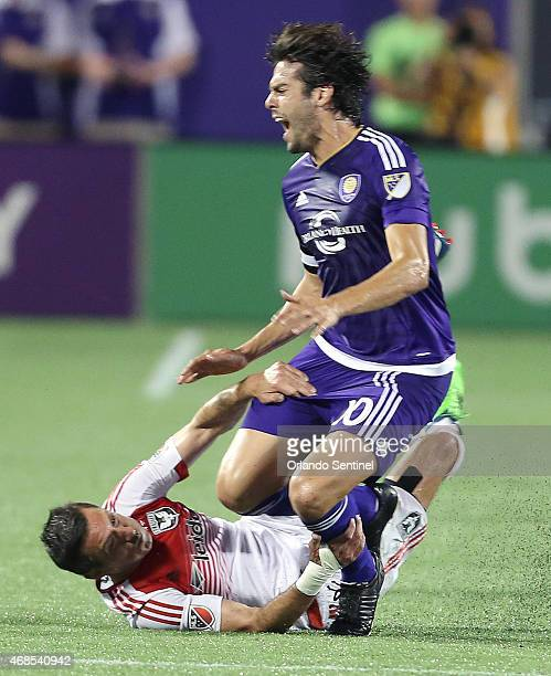 Orlando City's Kaka screams as he is brought to the ground by DC United's Davy Arnaud at the Orlando Citrus Bowl on Friday April 3 2015 DC United won...